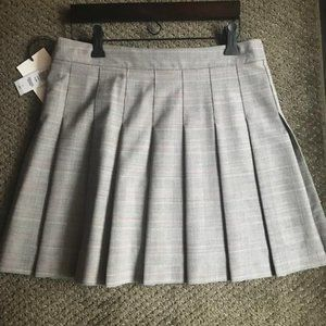 Pleated brown/cream/pink mini skirt from Aritzia